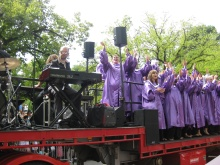 Gospel singers singing 'Oh happy day' at the Moomba Parade