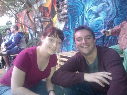 Me and Andrew with Section 8's wall graffiti behind us