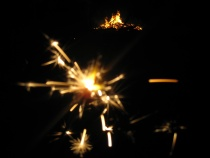 Sparklers by fire light