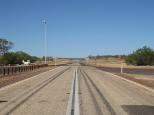 Standing on the Stuart Highway by day