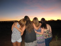 Wwoofing girls watching the sunset