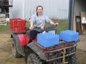 Off to collect eggs on the quad bike