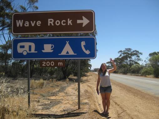 Sarah waving at Wave Rock