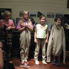Some very cute kids demonstrating the under garments a pearl diver wore